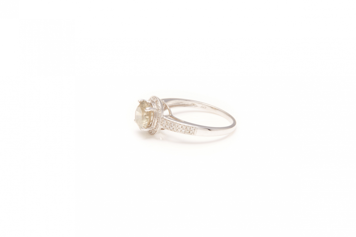 Lot 50 - A 10K WHITE GOLD AND DIAMOND HALO DRESS RING