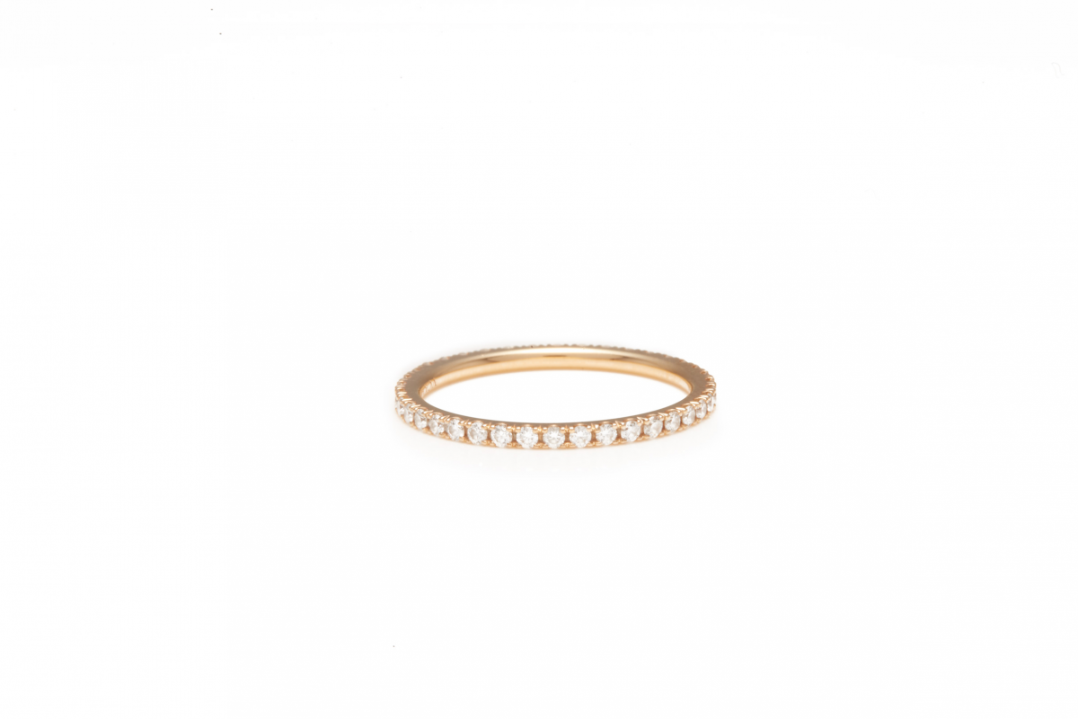 Lot 32 - VAN CLEEF & ARPELS - A DIAMOND AND ROSE GOLD RING