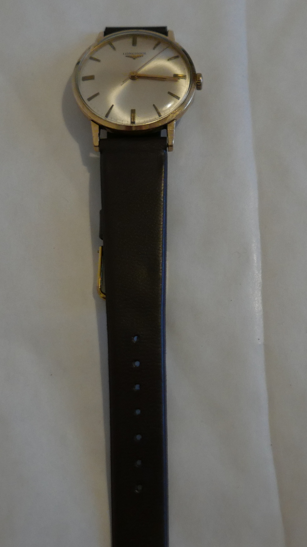 Lot 47 - Vintage 9 karat Gold Gents Longines Watch in an working order.