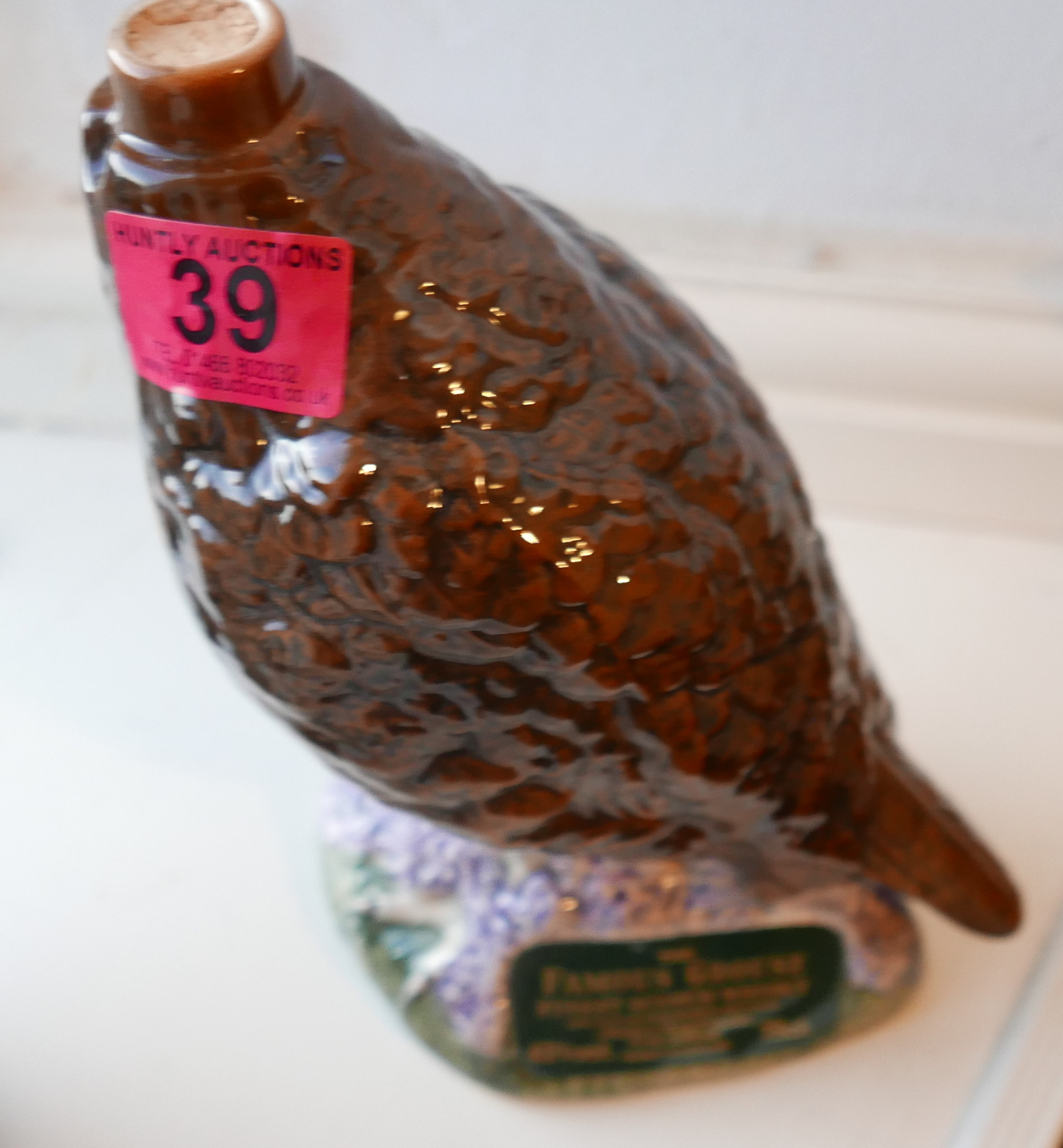 Lot 39 - Royal Doulton Golden Eagle and Beswick Grouse Decanters Full of Whisky.