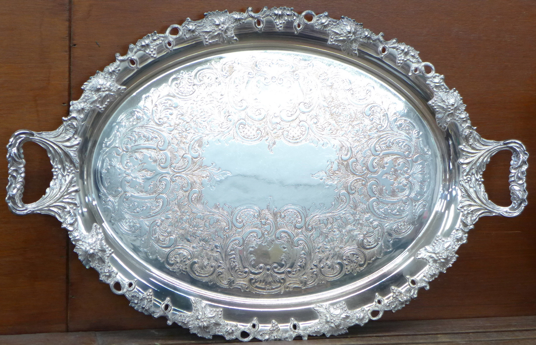 Lot 620 - A silver plate on copper two handled tray