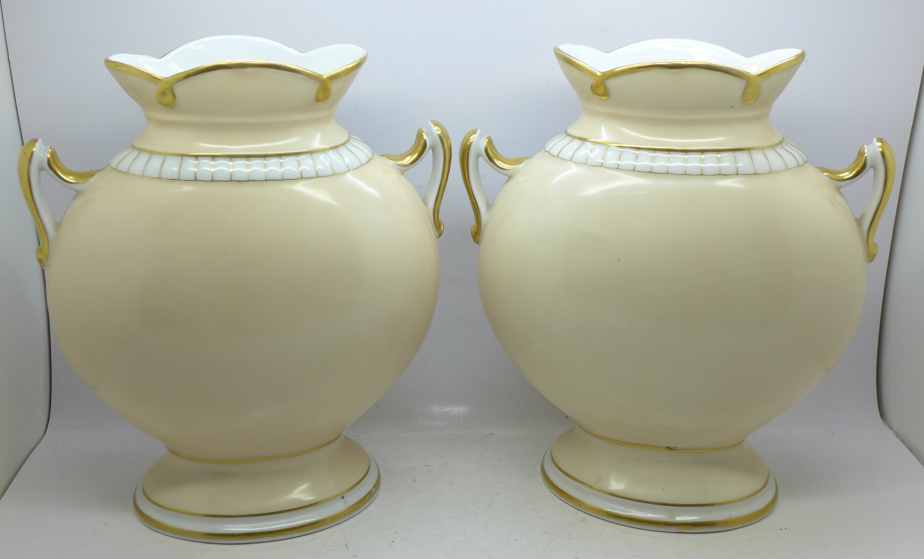 Lot 623 - A pair of continental two handled vases