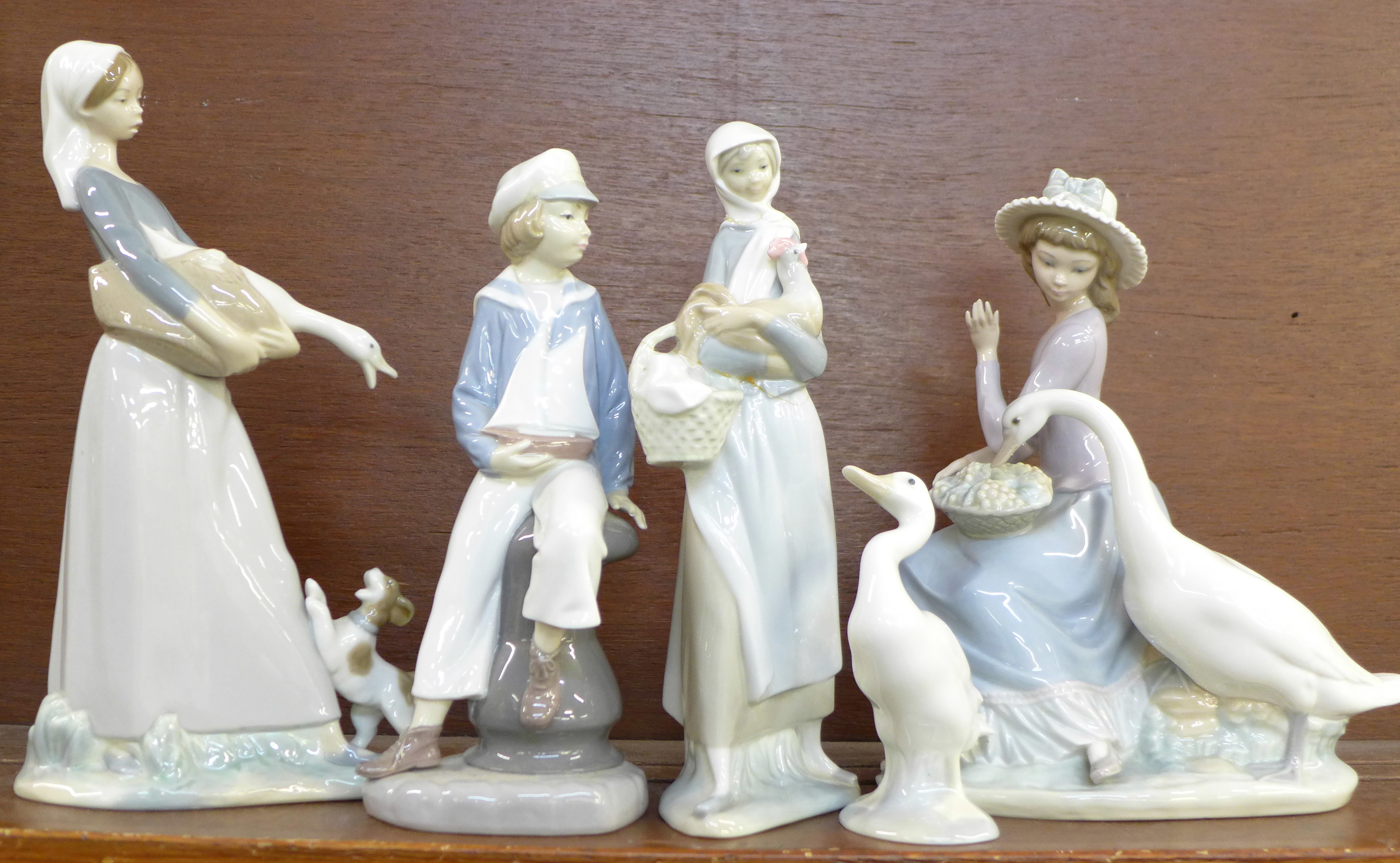 Lot 609 - Five Lladro figures, lady with chicken and boy,