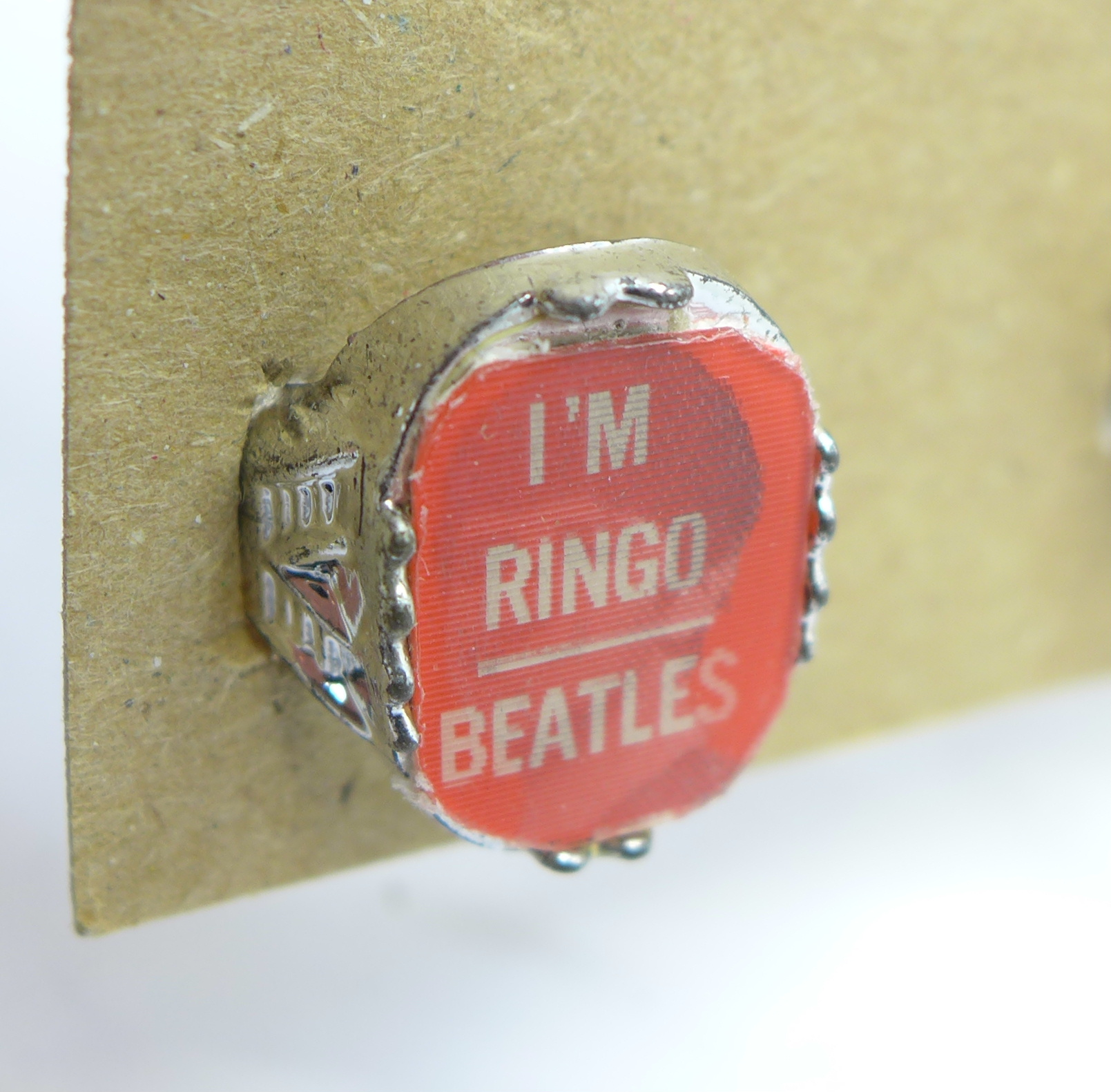 Lot 657 - Four 1960's The Beatles Flasher Rings,