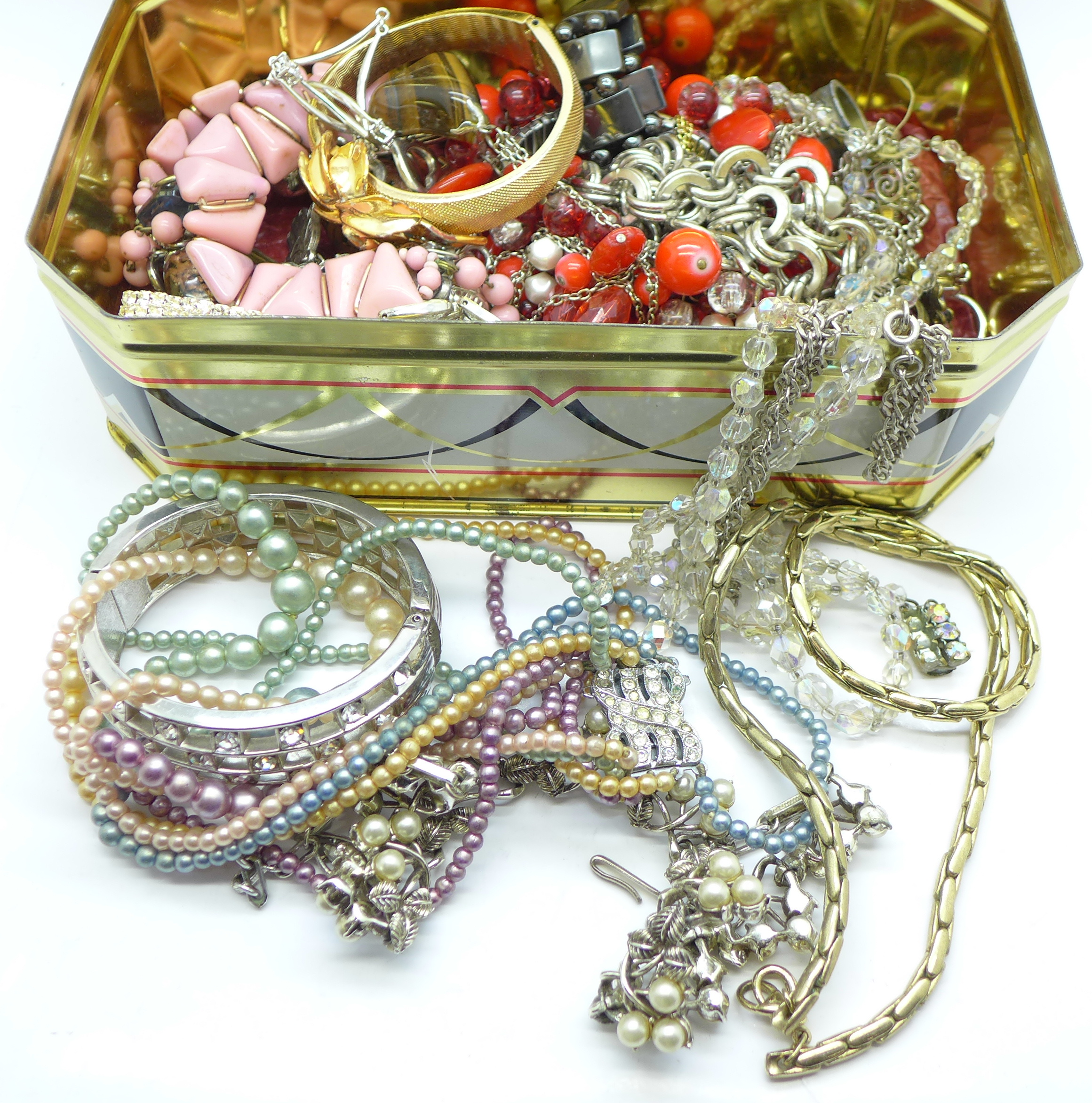Lot 650 - A tin of costume jewellery, 1.