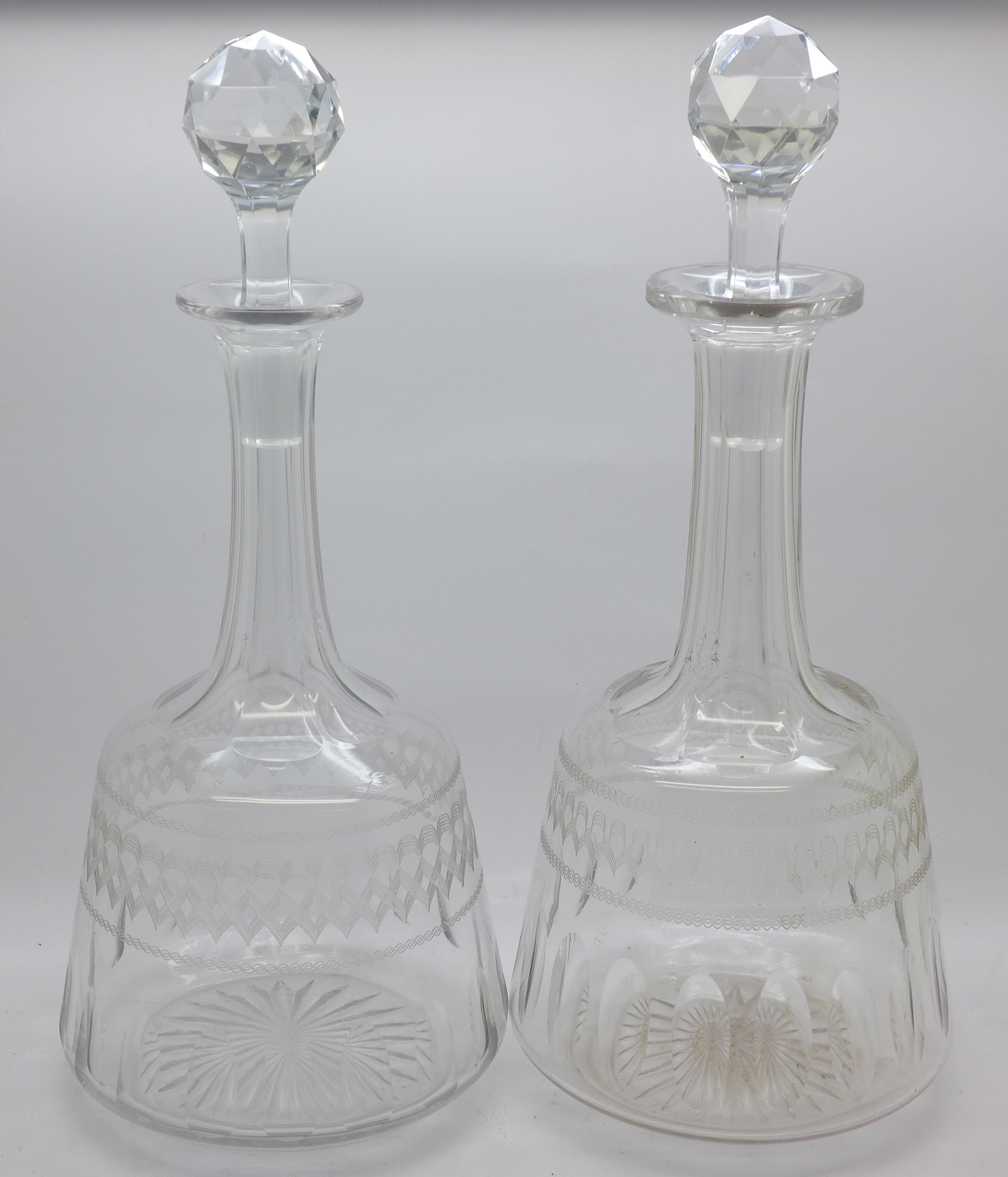Lot 626 - A pair of etched glass decanters