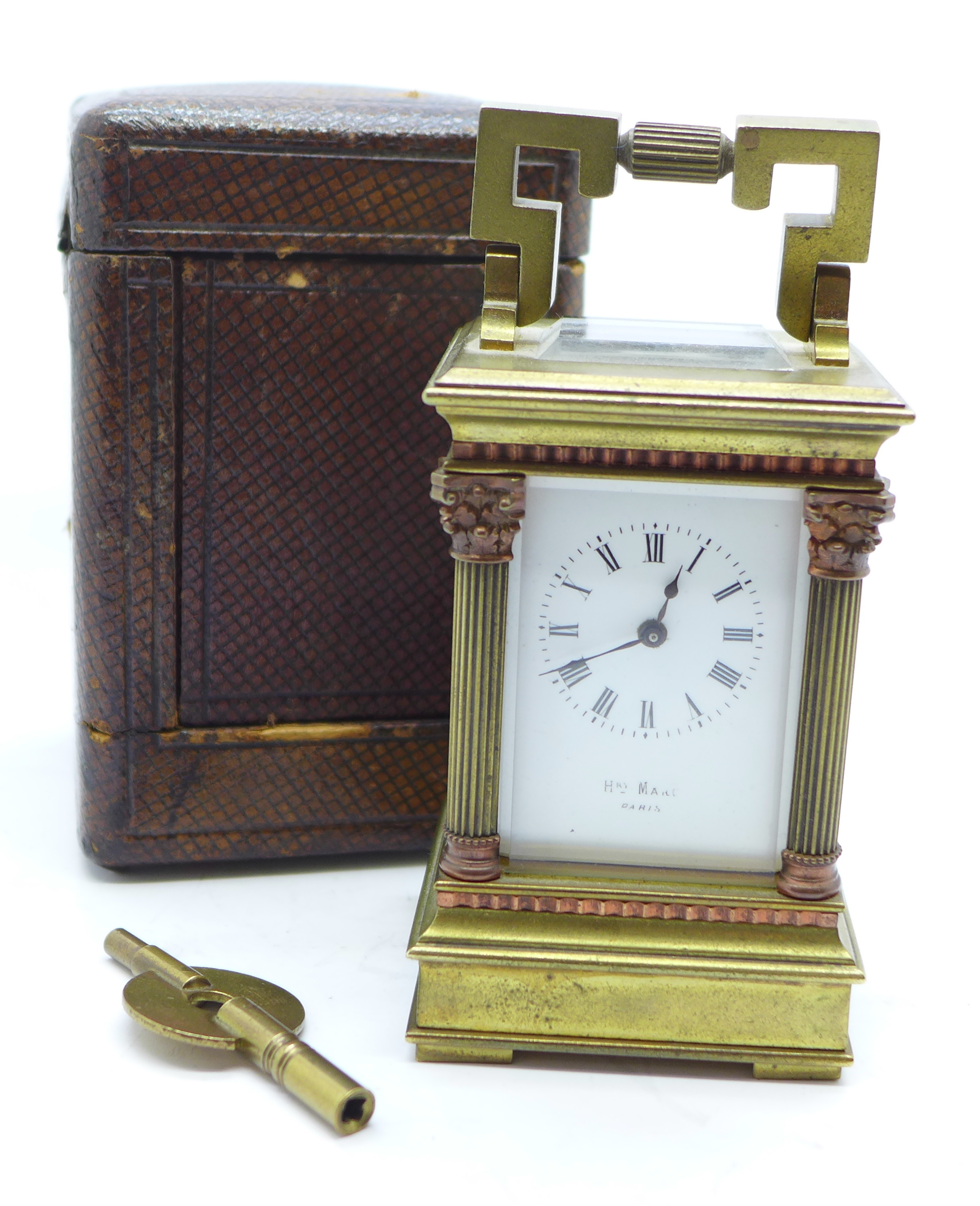Lot 627 - A miniature French brass carriage clock with four Corinthian columns, in brown Morocco leather case,
