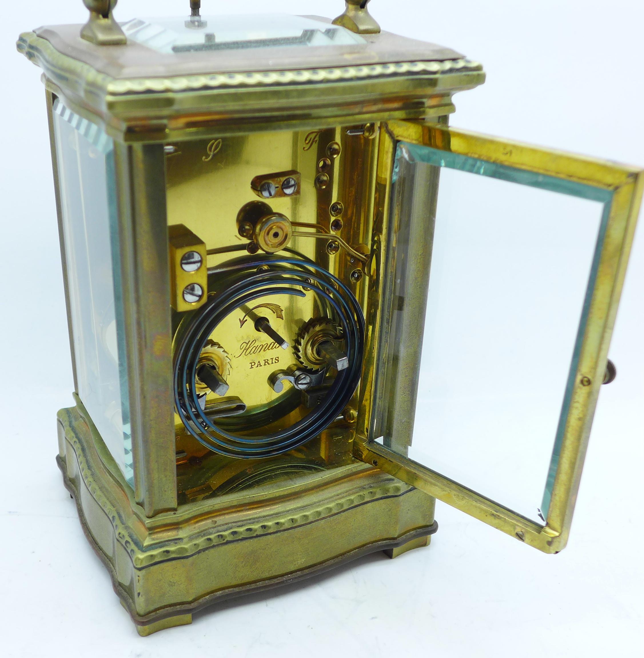 Lot 629 - A brass repeater carriage clock, enamel dial, movement signed Paris, 14cm,