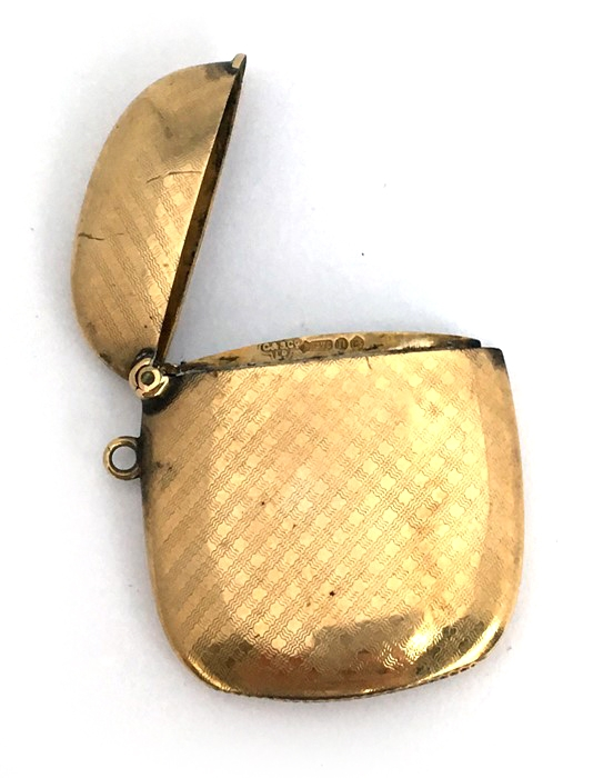 Lot 89A - A 9ct gold vesta case, of slender cushion form, with engine-turned decoration, London, C&S Co, 1908,