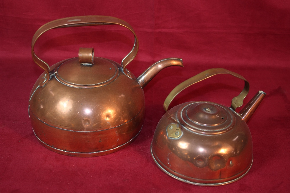 Lot 18 - Two shaped copper kettles