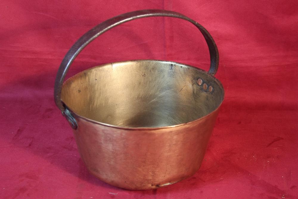 Lot 51 - A brass jam pan with metal handle