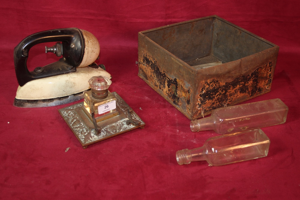 Lot 26 - An old tilley iron and a brass inkwell