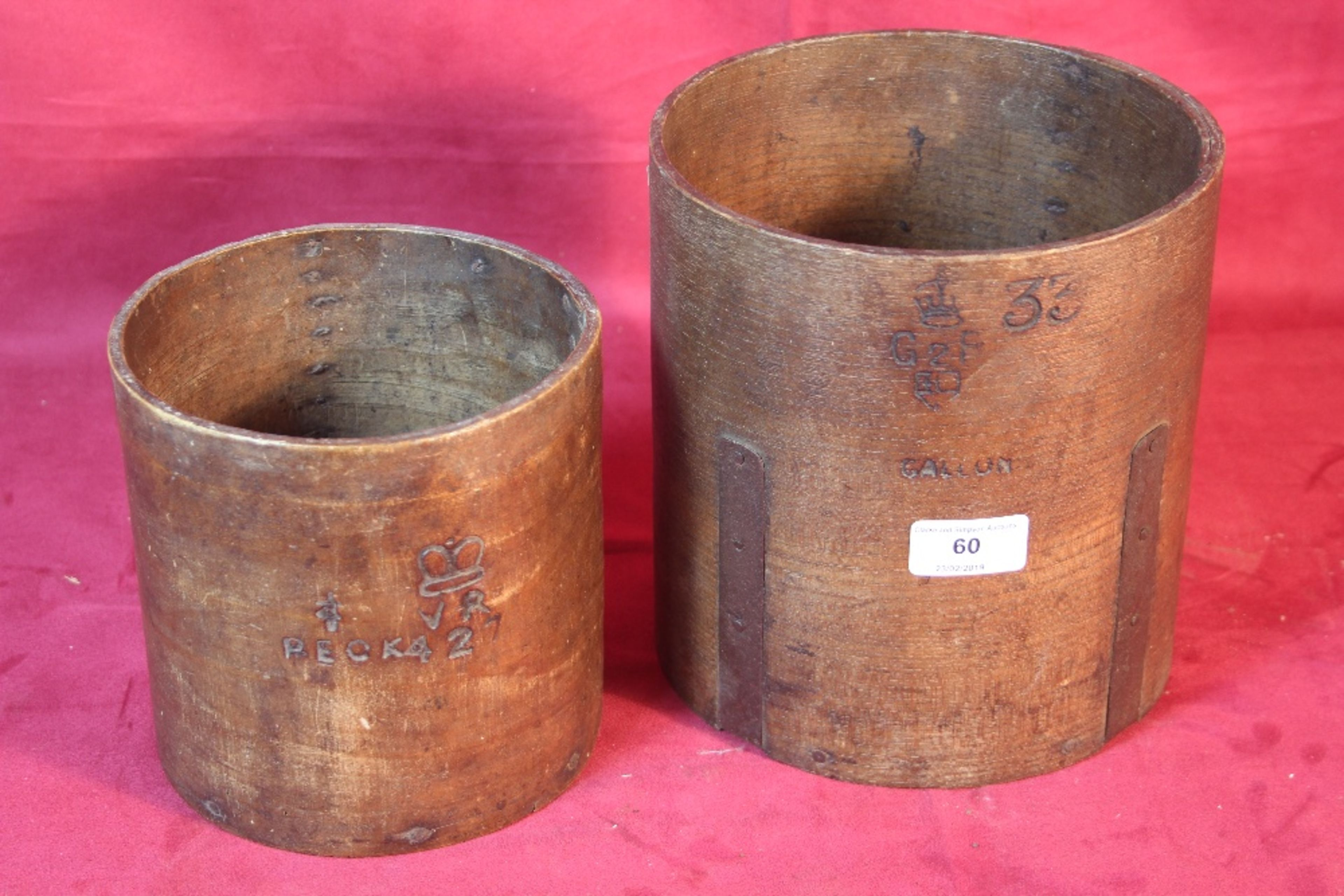 Lot 60 - Two old wooden measures