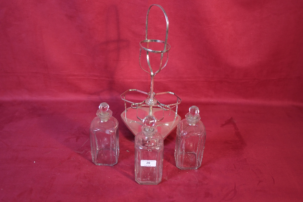 Lot 20 - A plated three bottle decanter stand