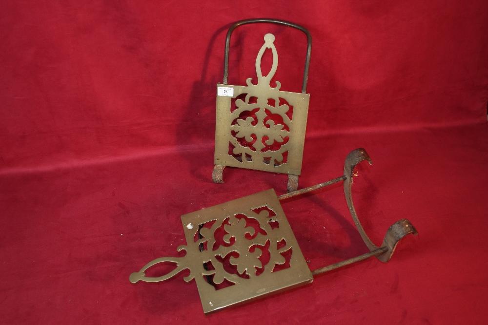 Lot 27 - Two ornate brass fire trivets