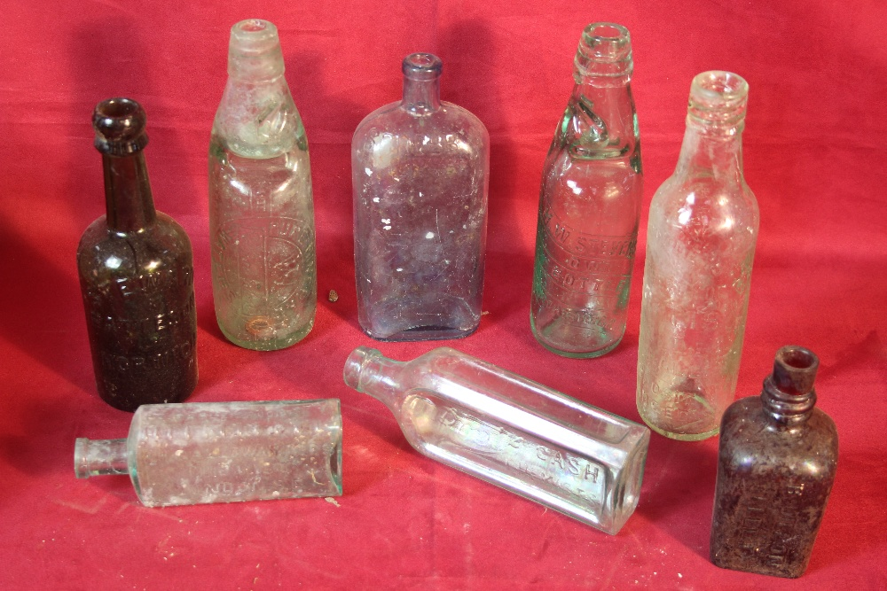 Lot 21 - A box of vintage bottles including Ipswich and Col