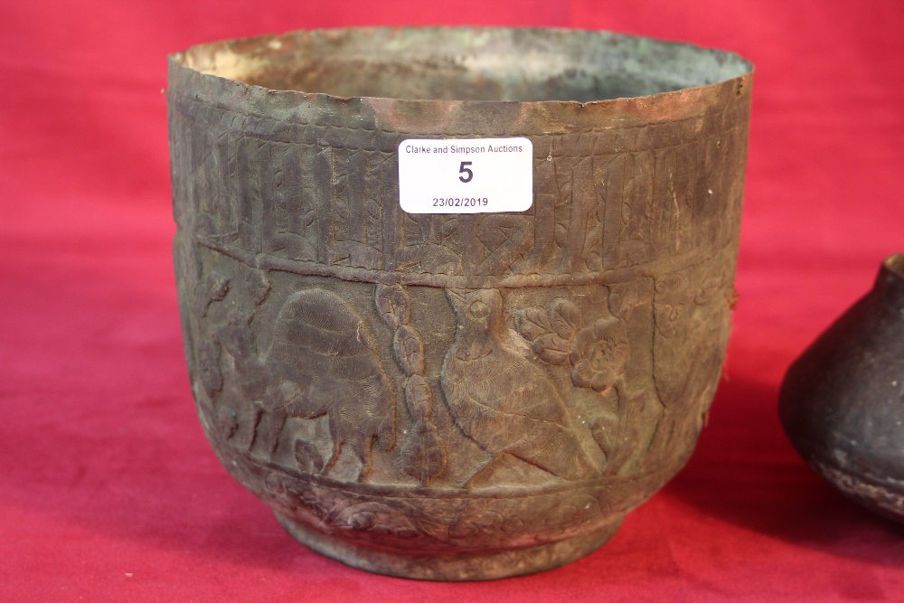 Lot 5 - A copper vase, decorated with camels and another s