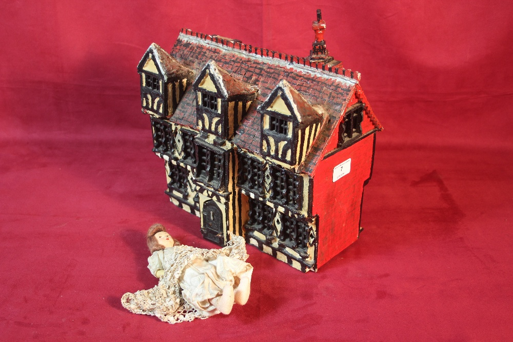 Lot 7 - A vintage doll's house and doll