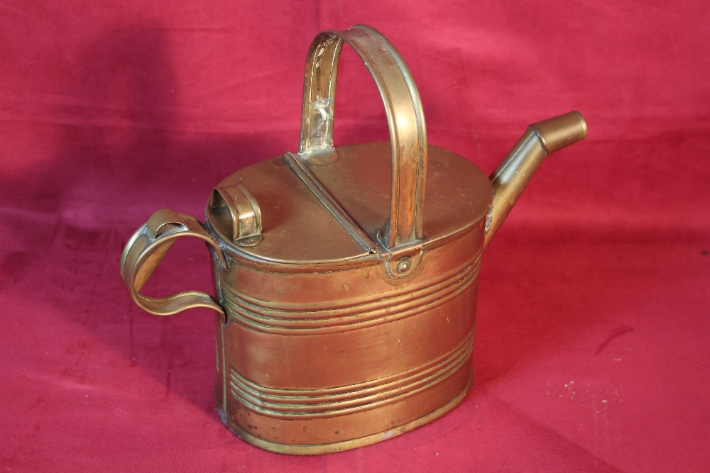 Lot 44 - A small brass watering can