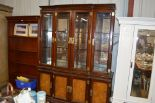 Lot 198 - A large Chinese glazed cabinet raised on cupboard