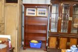 Lot 200 - A reproduction mahogany open fronted bookcase