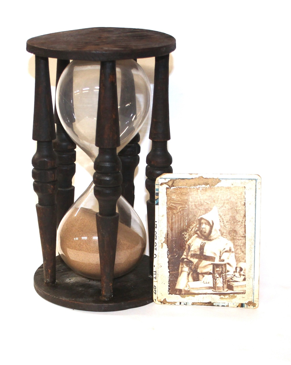 A large antique wooden hour glass with original bl