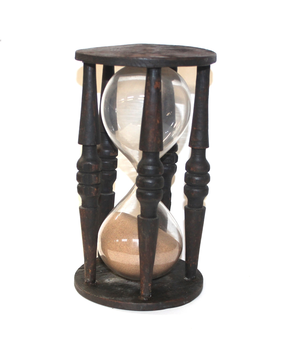 Lot 74 - A large antique wooden hour glass with original bl