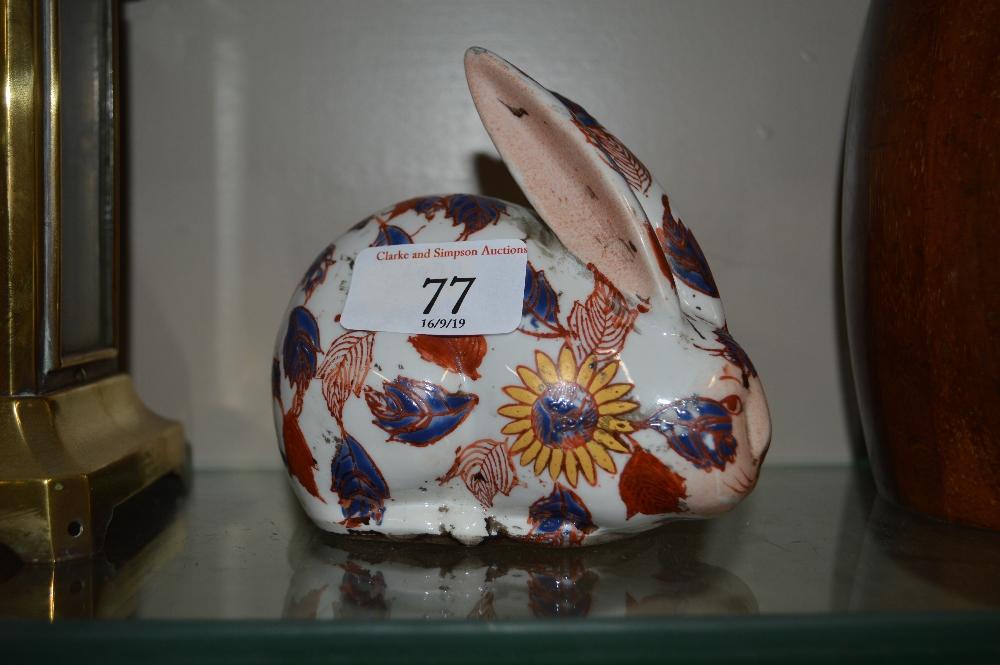 Lot 77 - An Imari patterned rabbit ornament