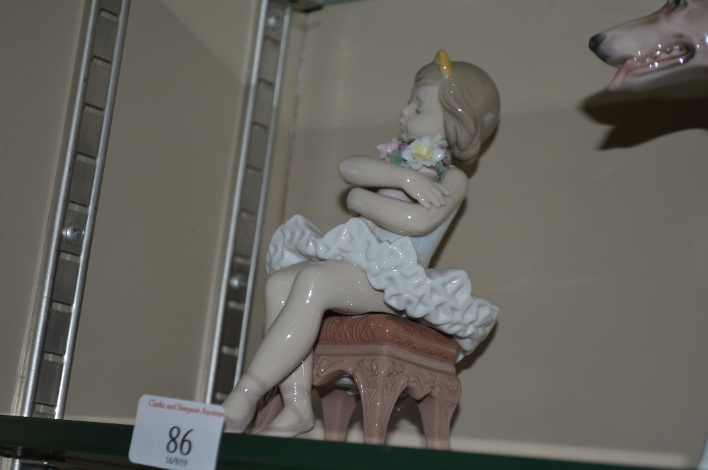 Lot 86 - A Lladro figurine in the form of a young girl seat