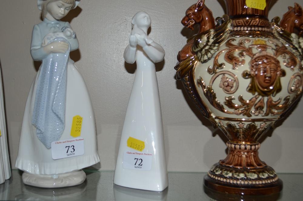 "Lot 72 - A Royal Doulton white glazed figure ""Peace"""