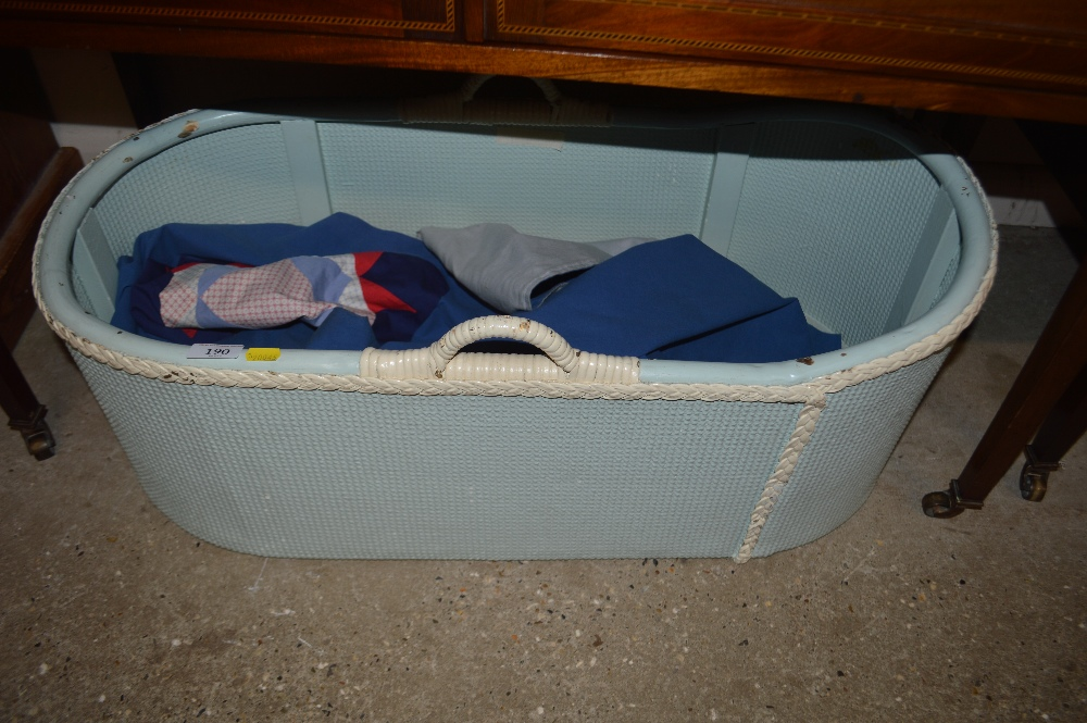 Lot 190 - A loom style baby's basket and quilt