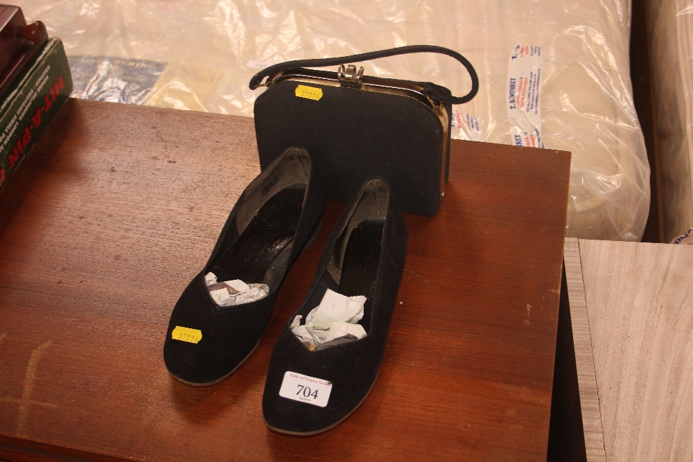 Lot 704 - A pair of Lady's shoes and a purse