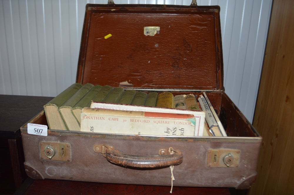 Lot 507 - A suitcase and contents of various books