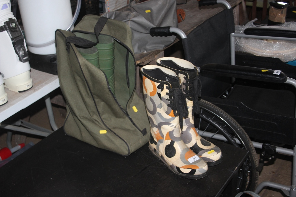 Lot 997 - A pair of lady's Wellington boots; together with a