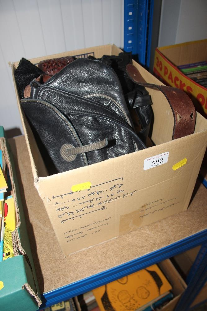 Lot 592 - A box of various lady's bags; belts etc