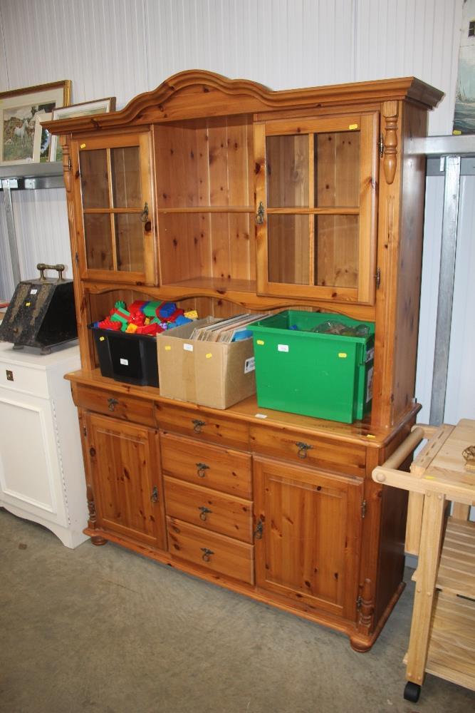 Lot 555 - A modern pine dresser raised on cupboard base
