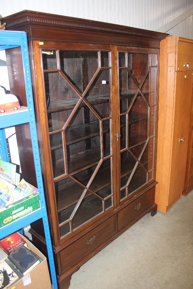 Lot 569 - A mahogany glazed bookcase fitted two drawers belo