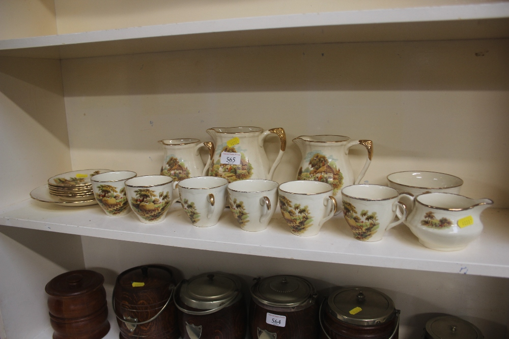 Lot 565 - A quantity of teaware decorated with country scene