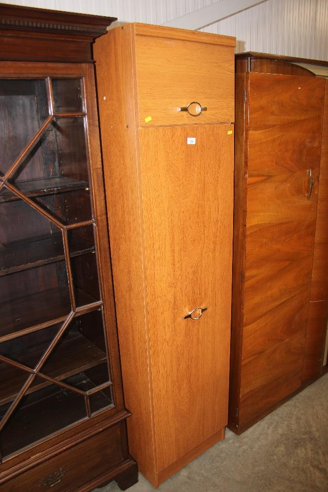 Lot 568 - A teak effect narrow cupboard