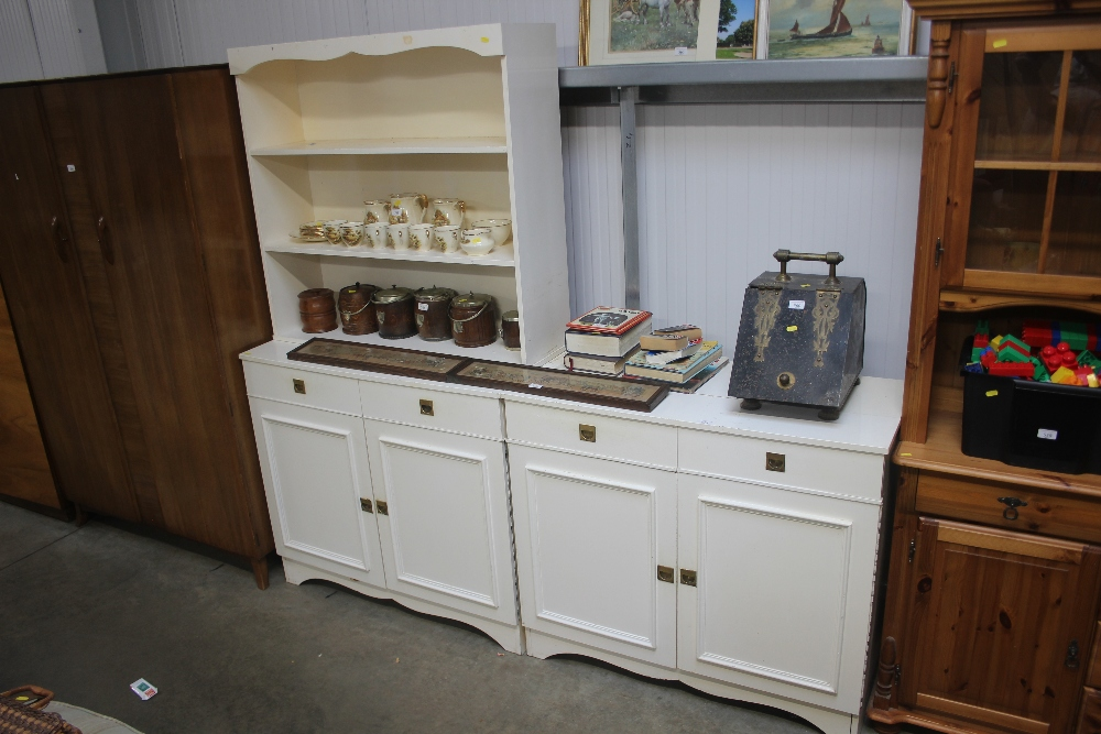 Lot 559 - A white painted two door cupboard; together with a