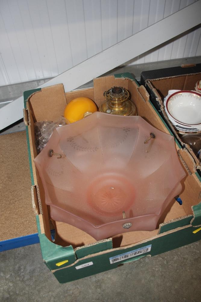 Lot 589 - A pink glass light shade; oil lamp etc