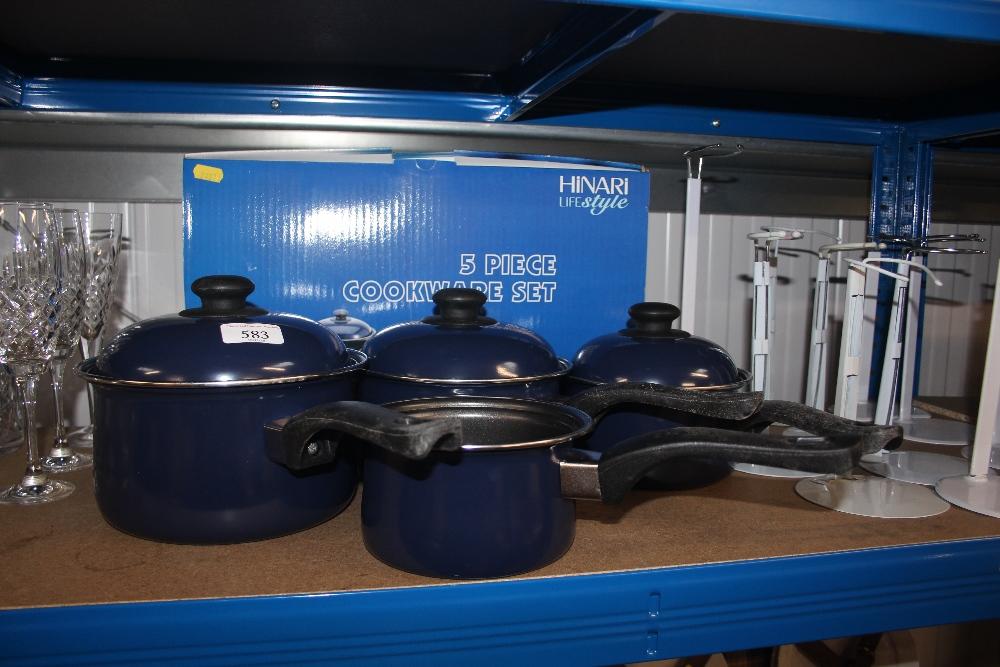 Lot 583 - A five piece Cookware set