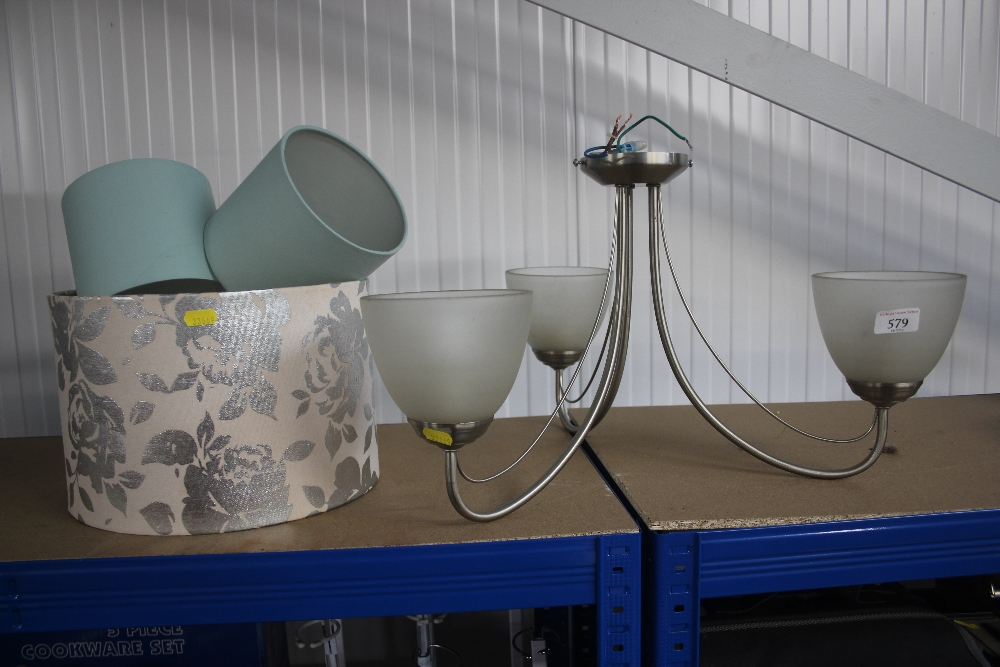 Lot 579 - A hanging light fitting and a quantity of lamp sha