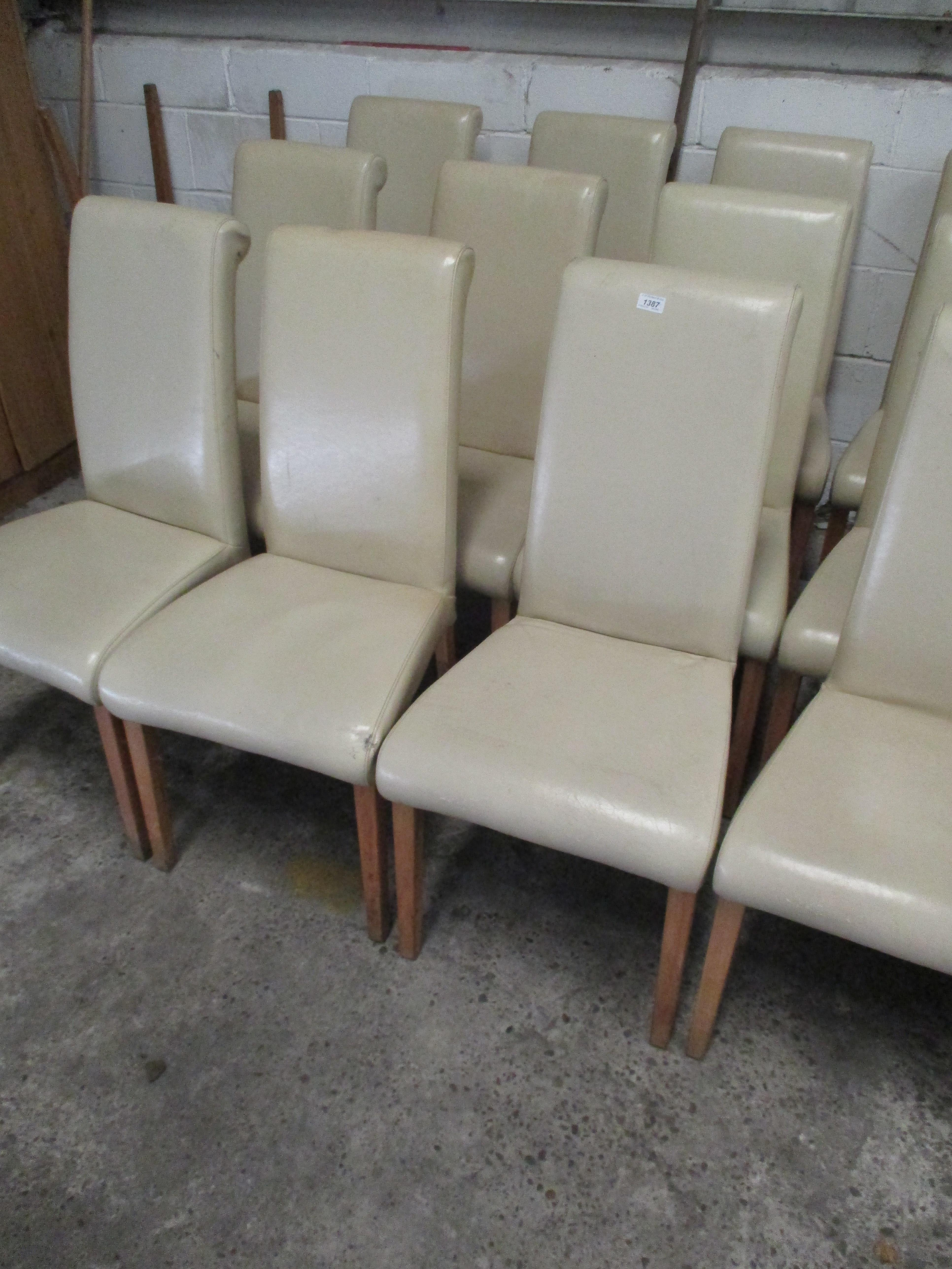 Lot 1387 - 11 x cream leather upholstered high back dining chairs on light wooden feet
