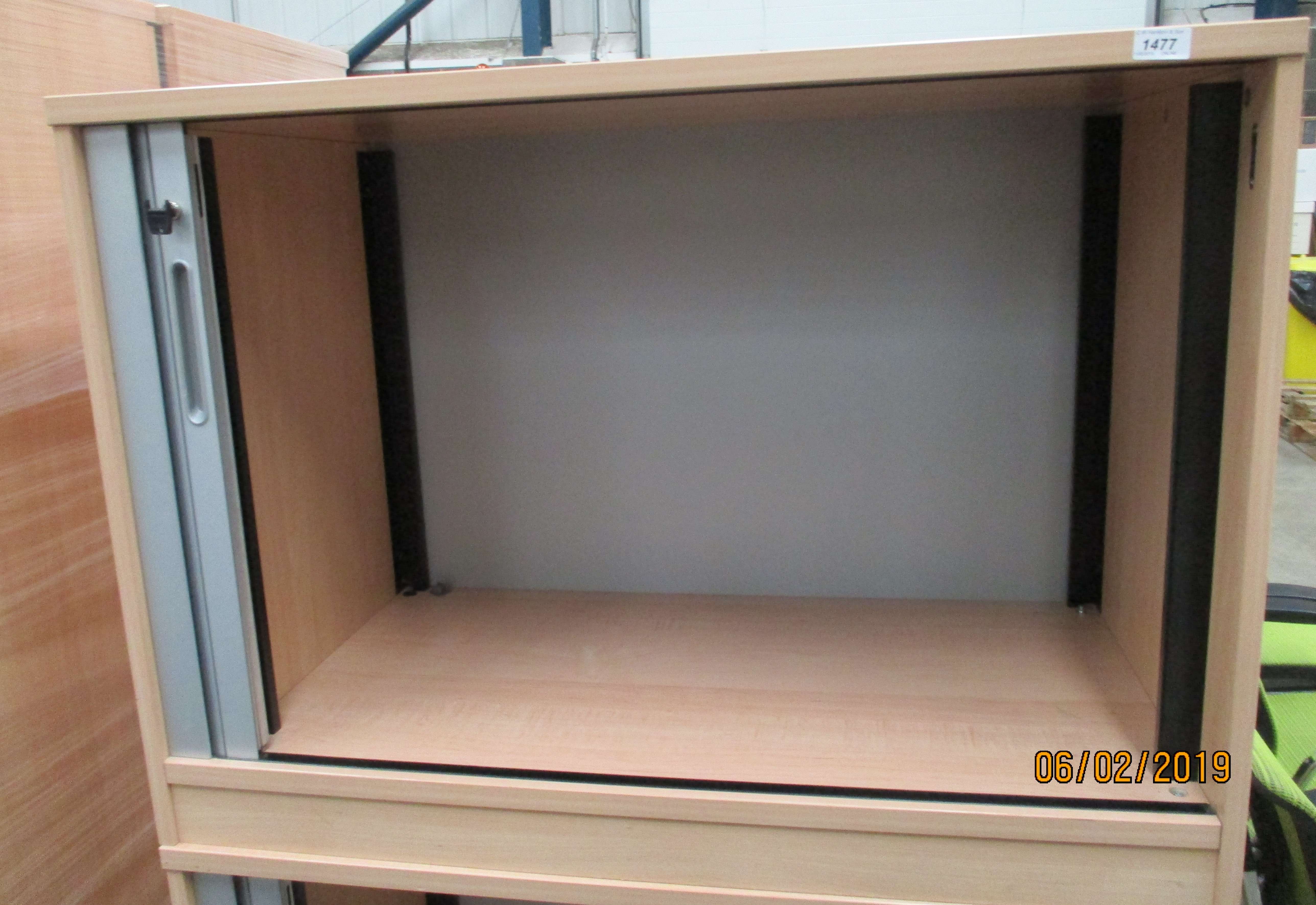 Lot 1477 - A pine finish tambour front stationery cabinet 100 x 65cm complete with key - no shelves