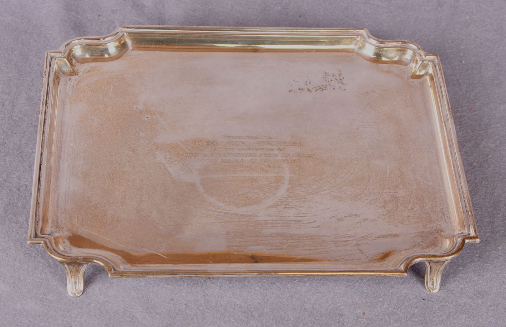 Lot 52 - A presentation tray of shaped rectangular form, four shaped supports,