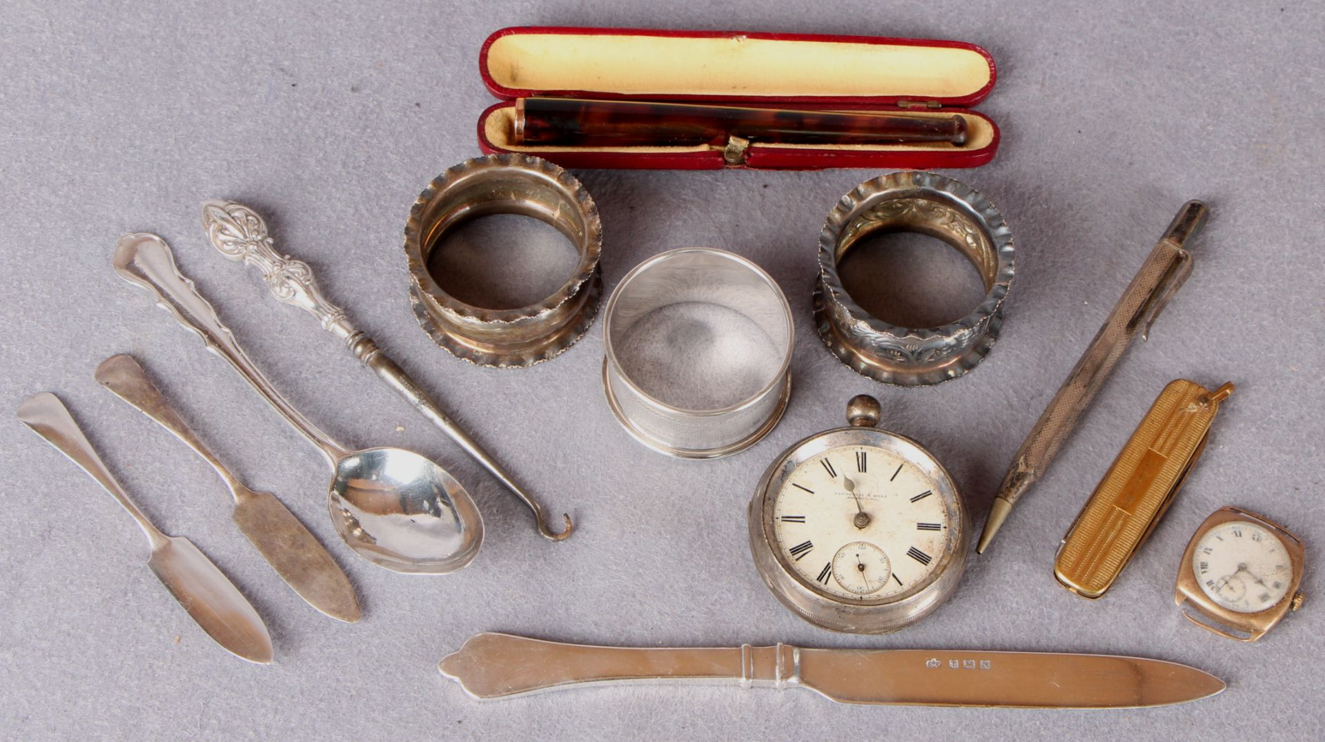 Lot 57 - A small collection of silver and collectables including napkin rings, pocket watch (at fault),