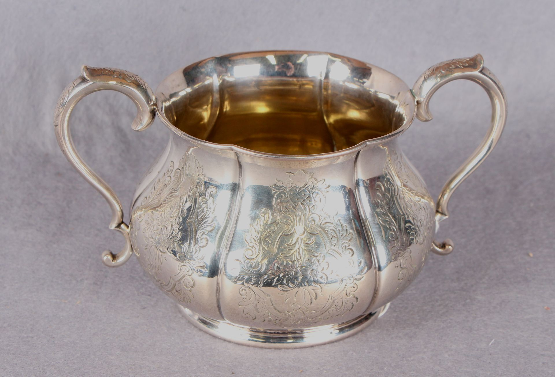 Lot 37 - A Victorian two handled sugar basin of baluster shaped circular form, engraved with flowers,