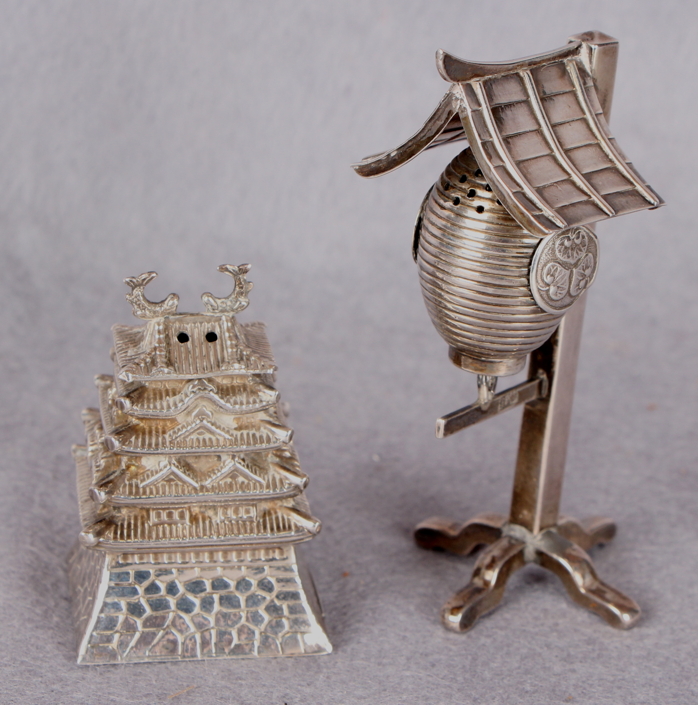 Lot 44 - Two Chinese silver table condiments, one formed as a lantern,
