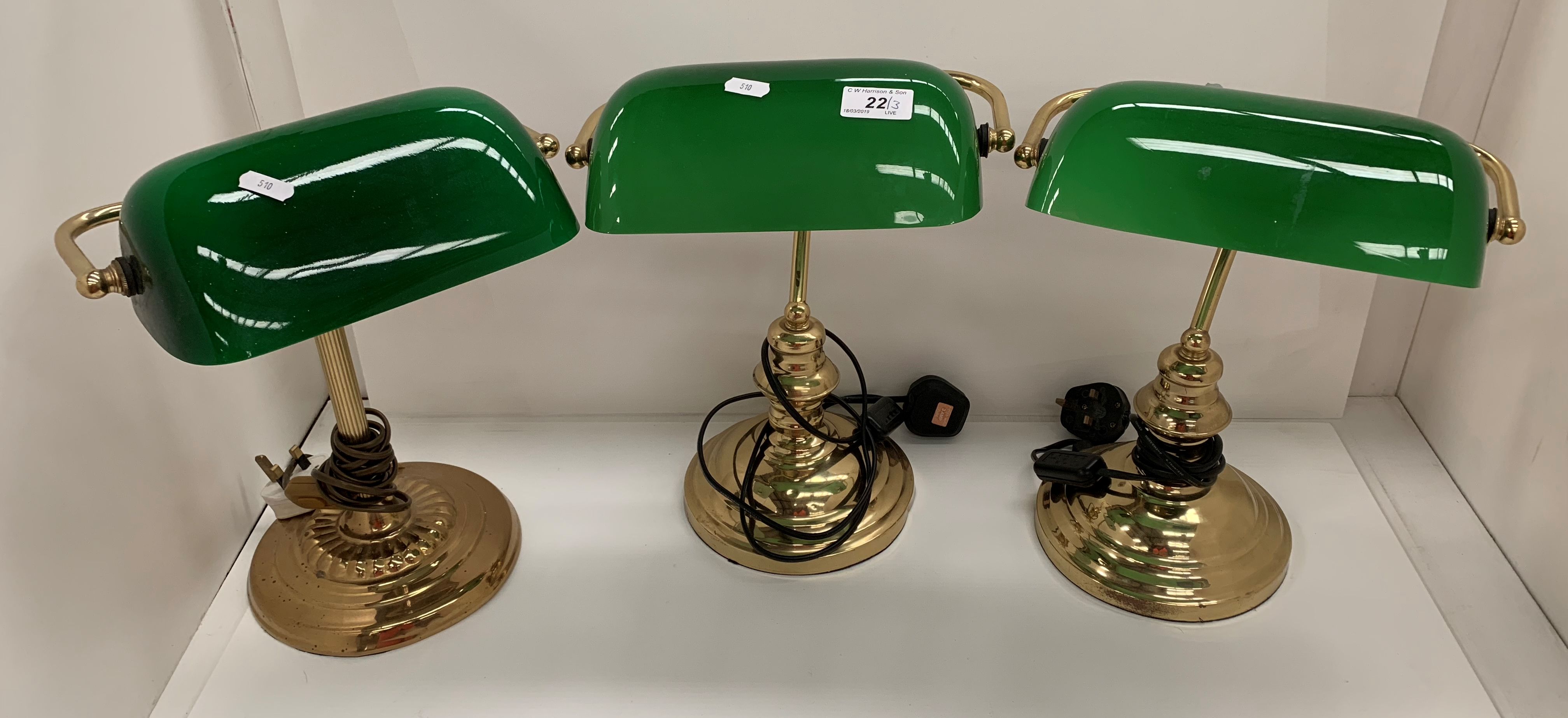 Lot 22 - Three brass table lamps with green glass shades